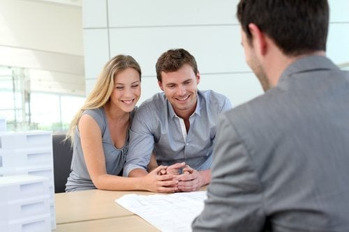 couple talking with loan officer