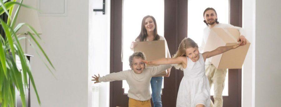 family walking through front door